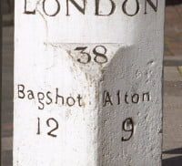 White distance stone showing distance to London, Bagshot and Alton.