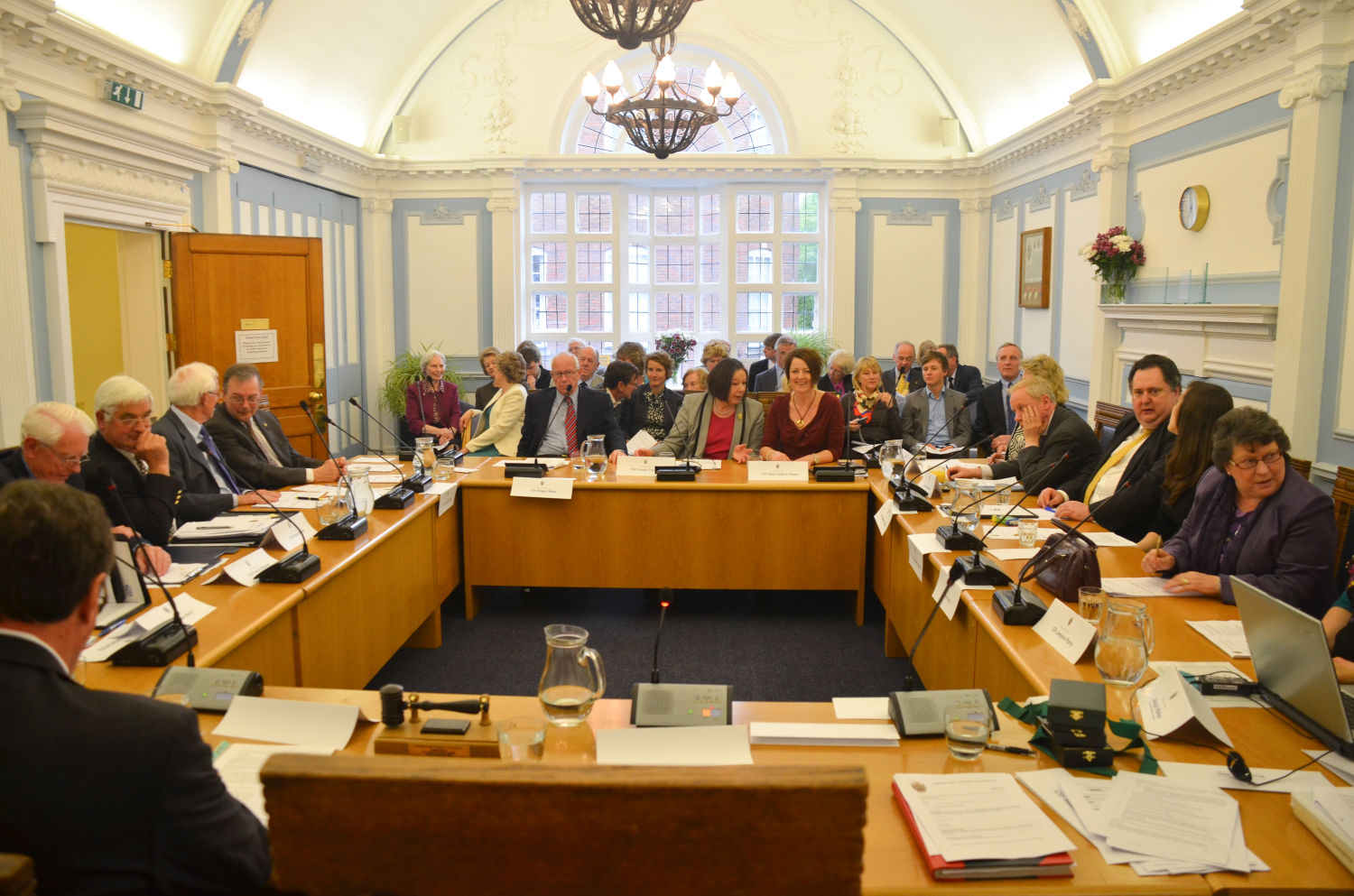 Councillors in council chamber. meeting