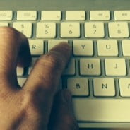 Hand typing on keyboard. © Julie Jackson