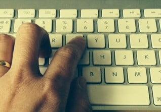 Hand typing on keyboard. © Julie Jackson