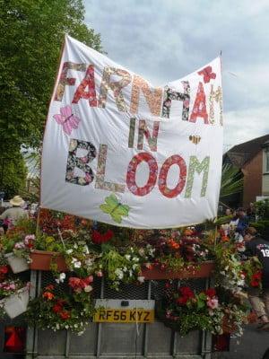 Trailer, Farnham in Bloom banner, flowers on trailer. Carnival float.
