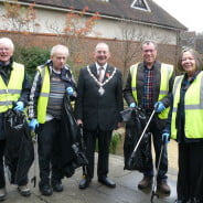 The Mayor and four councillors with black rubbish sacks and litter pickers.