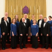 Eleven male and female choir members in smart dress.