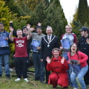 Happy young people and the Mayor