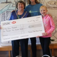 Three people including the Mayor with a large cheque.