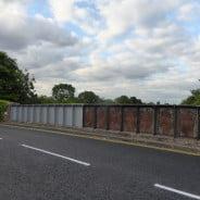 Railway bridge, partly painted.