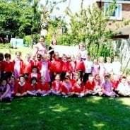 Large group of children and the Mayor in garden.