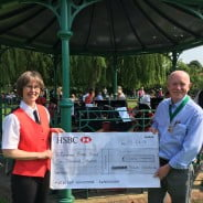 Deputy Mayor of Farnham, Cllr Mike Hodge presents a cheque to Farnham Brass Band cheque handover