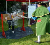 Farnham's Town Clerk gets a soaking from the Town Crier at the 2016 Spring Festival.