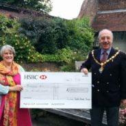 Caption: The Mayor of Farnham, Cllr John Ward presents a cheque to Jo Aylwin.