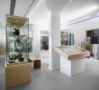Display cabinets in a white painted gallery