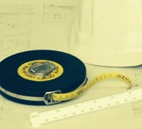 Tape measure, hard hat, scale rule and plans