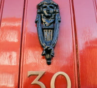 Red front door, door knocker, no 30.