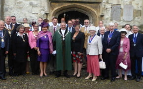 Mayor and guests outside church, civic service