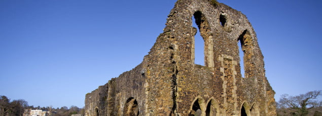 Ruins of a former abbey. Blue sky