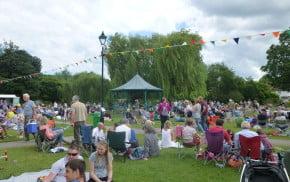 People, picnics, music, bunting, meadow