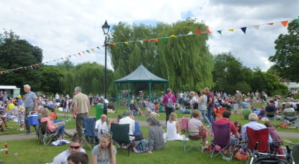 People, picnics, music, bunting, meadow