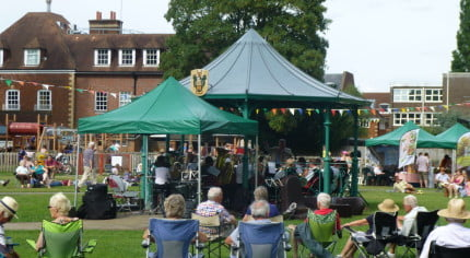 People, bandstand, music in the meadow.