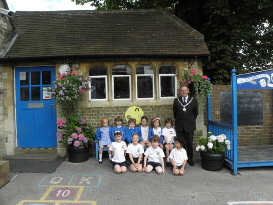 School children, Mayor, school, hanging baskets.
