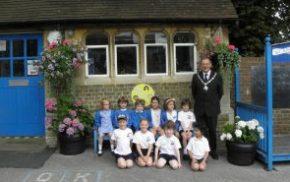 School children, Mayor, school, hanging baskets.