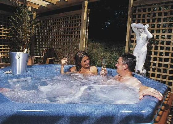 Male and Female in blue hot tub