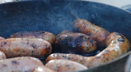 Cooking sausages. Frying pan.