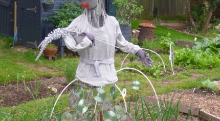 Scarecrow, plant pot hat, silver jumper, CD skirt, Lady Gaga