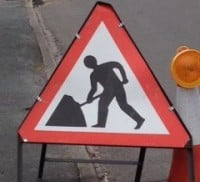 Triangular shaped roadworks sign.