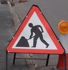Triangular shaped roadworks sign.