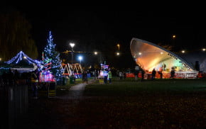 Park at night, with a stage, christmas lights and christmas tree