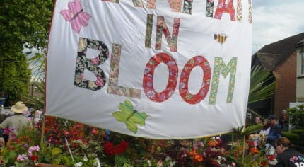 Trailer, Farnham in Bloom banner, flowers on trailer. Carnival float.