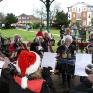 The Farnham Brass Band playing in the bandstand in Gostrey Meadow.