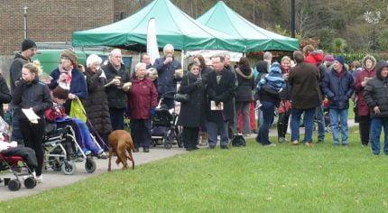 Crowd of people singing carols in Gostrey Meadow