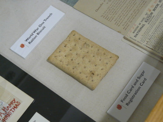 World War One trench ration biscuit in a display case.