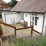 Patio area at rear of white walled village hall