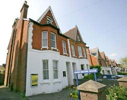 Outside Farnham Quakers meeting house. Semi detached Victorian building.