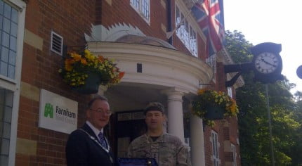 Mayor and soldier outside council offices.