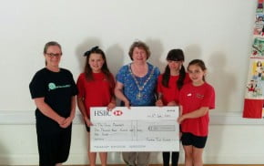 The Mayor presents a cheque to young dancers.