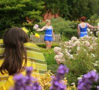Young people dancing in a garden