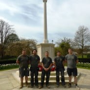 Five males in front of war memorial
