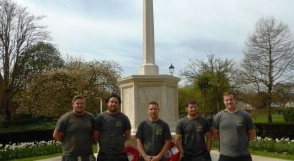Five males in front of war memorial