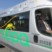 Mayor in driver's seat of a hoppa bus