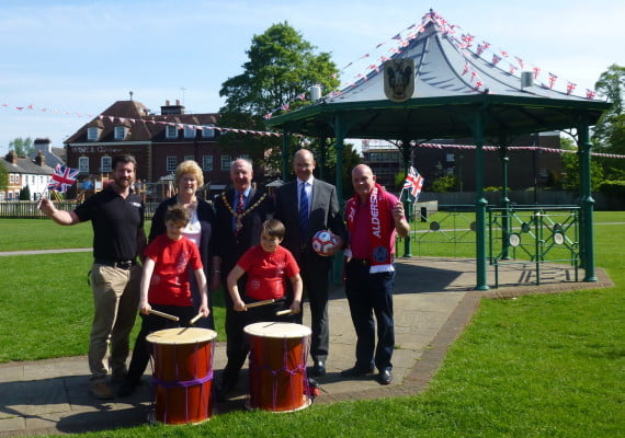 John Quin, Anytime Fitness; Gillian Ward; Cllr John Ward, Mayor of Farnham; James Grundy, Trueman & Grundy and Mark Butler, Aldershot Town Football Club with children are from Potters Gate Taiko Drumming Club.