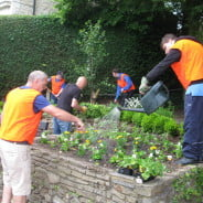 Farnham in Bloom improve the East Street flower bed.