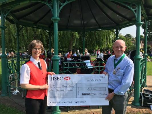 Deputy Mayor of Farnham, Cllr Mike Hodge presents a cheque to Farnham Brass Band cheque handover
