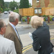 Judges looking at a garden area in a street.