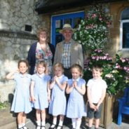 Mayor and Mayoress of Farnham with five school children.