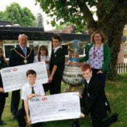 School children receive grant cheque from Mayor.