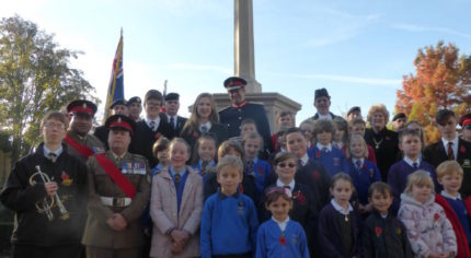 Group of children in front of war memorial