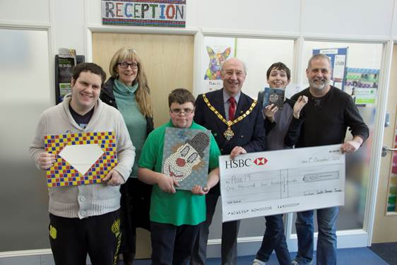 Group of young people with the Mayor and a large cheque.